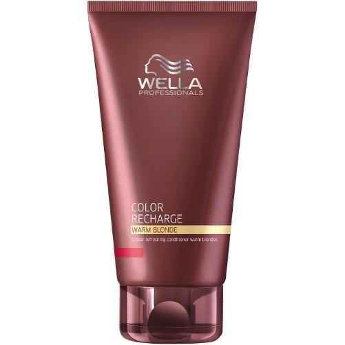 Color Recharge Warm Blonde ConditionerWella Professional<br>Производство: Германия Семейство: восточные Бальзам для освежения цвета теплых светлых оттенков. Это средство создано для осевежения цвета теплых оттенков. Свойства бальзама позволяют ему идеально сочетаться с красителями Велла. Окрашенные волосы не меняют свой оттенок при использовании. Состав продукта обогащен активным ингредиентами, среди которых экстракт шелка, пантенол и кератин. Такие ингредиенты способны эффективно регенерировать структуру волос, питать и смягчать их, а также придавать им сияние и блеск. В составе присутствуют и красящие пигменты. Как следствие активного применения бальзама для освежения цвета теплых светлых оттенков можно отметить яркий, красивый, насыщенный и богатый цвет волос, волосы при этом сияют здоровьем и активно восстанавливаются. Применение: бальзам следует выдавить на ладошки, растереть между ними, распределить по всем волосам массажными движениями на мокрые волосы, хорошенько вспенить, оставить для глубокого воздействия на 8-10 минут, затем теплой водой тщательно смыть. Продукт можно применять на всех типах волос ежедневно.<br><br>Линейка: Color Recharge Warm Blonde Conditioner<br>Объем мл: 200<br>Пол: Женский<br>Аромат: восточные