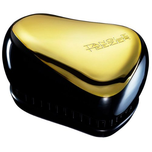 Compact Styler Gold RushTangle Teezer<br>Производство: Великобритания Compact Styler Gold Rush от Tangle Teezer - будет с  вами, где бы вы ни находились! Благодаря компактной форме эта расчёска  поместится в любую сумочку, а плотно прилегающая крышка защитит расчёску  от пыли и повреждений. Эргономичная форма позволяет легко расчёсывать  как сухие, так и влажные волосы. Благодаря уникальному строению  зубчиков, расчёска мягко скользит по волосам, не повреждая и не  травмируя их. После использования расчёски волосы приобретают здоровый  вид и блеск, становясь гладкими и шелковистыми.  <br><br>Линейка: Compact Styler Gold Rush<br>Объем мл: (90&amp;#215;68&amp;#215;50мм.)<br>Пол: Унисекс