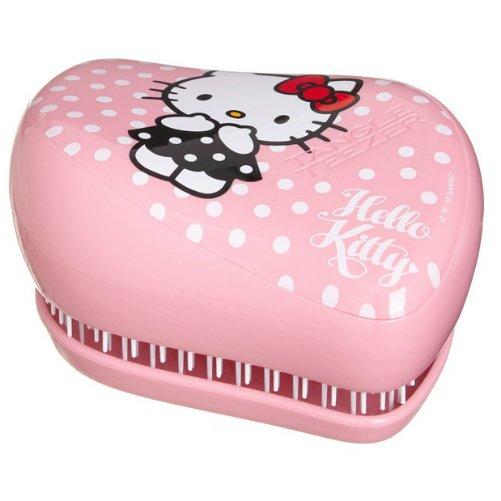 Compact Styler Collectables Hello Kitty PinkTangle Teezer<br>Производство: Великобритания Compact Styler Collectables Hello Kitty Pink от Tangle Teezer -  ультовый персонаж известного мультфильма - украшает и расчёску.  Расчёска выполнена в нежно-розовом цвете с принтом в горох. Аксессуар  будет с вами, где бы вы ни находились! Благодаря компактной форме эта  расчёска поместится в любую сумочку, а плотно прилегающая крышка защитит  расчёску от пыли и повреждений. Эргономичная форма позволяет легко  расчёсывать как сухие, так и влажные волосы. Благодаря уникальному  строению зубчиков, расчёска мягко скользит по волосам, не повреждая и не  травмируя их. После использования расчёски волосы приобретают здоровый  вид и блеск, становясь гладкими и шелковистыми.  <br><br>Линейка: Compact Styler Collectables Hello Kitty Pink<br>Объем мл: (90&amp;#215;68&amp;#215;50мм.)<br>Пол: Унисекс