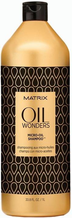 MatrixMatrix<br>Производство: США Oil Wonders Micro-Oil Shampoo &amp;ndash; Шампунь Оил Вандерс с микро-каплями масла. <br>Легкий шампунь Оил Вандерс, содержащий уникальную формулу с микро-каплями экзотического Марокканского арганового масла, бережно очищает и питает волосы, обеспечивая гладкость, дисциплину, невероятный блеск и мягкость.<br>Подходит для всех типов волос.<br>Способ применения: нанести на влажные волосы массирующими движениями. Тщательно смыть. При попадании в глаза немедленно промыть их водой.<br><br>Линейка: Matrix<br>Объем мл: 1000<br>Пол: Женский