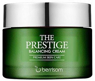 The Prestige Balancing Cream BerrisomBerrisom<br>The Prestige Balancing Cream. Крем для лица питательный<br>Многофункциональный уход премиум-класса &amp;ndash; серия The Prestige Balancing от Berrisom, воздействует на кожу сразу по нескольким направлениям: увлажняет, питает, успокаивает, осветляет и разглаживает морщины. Балансирующий крем оберегает поверхностные кожные ткани от воздействия ультрафиолета, обеспечивает защиту кожи от негативных воздействий окружающей среды.<br>Крем с легкой текстурой буквально тает на коже, насыщая каждую ее клеточку живительной влагой, а также необходимыми питательными компонентами.<br>В составе крема уникальная запатентованная AO5-формула из 5 экстрактов: экстракт энотеры стимулирует образование коллагеновых и эластиновых волокон кожи, активизирует кровоснабжение, замедляет процессы старения, мягко осветляет кожу, тонизирует ее, улучшает упругость. Кроме того, экстракт энотеры способствует сужению пор, регулирует активность сальных желез. Обладает мощными антиоксидантными свойствами.<br><br>Экстракт камелии защищает поверхностные слои кожи от вредного солнечного излучения и свободных радикалов, замедляет процессы старения клеток. Кроме этого, он оказывает увлажняющее действие, снимает раздражение и успокаивает дерму.<br>Экстракт клюквы усиливает обменные процессы в коже, сохраняет в ней влагу. Благодаря дубильным веществам, экстракт клюквы оказывает противовоспалительное и бактерицидное действие. Антиоксидантные свойства клюквы незаменимы для зрелой и увядающей кожи.<br>Экстракт ежевики способствует заживлению воспалений и раздражений, очищает от комедонов и отмерших клеток, повышает эластичность и упругость кожи, тонизирует, освежает, устраняет серость и желтизну, наполняет кожу необходимыми микроэлементами и витаминами, возвращает ей сияние.<br>Экстракт бузины улучшает структуру кожи и способствует быстрому заживлению ее повреждений, придает коже эластичность.<br>Аденозин в составе крема регулирует окислительно-восстановительные 